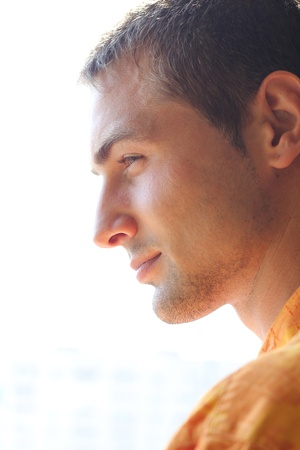 male face profile: profile of handsome man outdoors Stock Photo