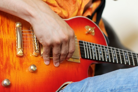 masters of rock: hands on guitar. Really great shot capturing detail of a guitarist
