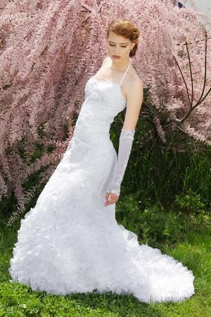 Beautiful bride woman, model posing outdoors photo