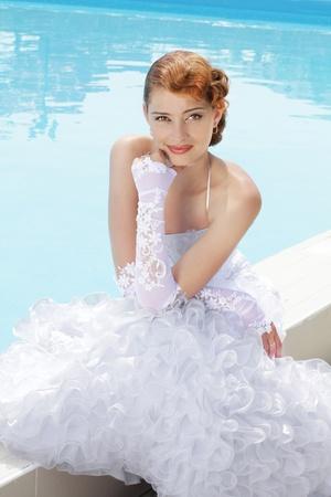 wedding, smiling bride swimming pool photo