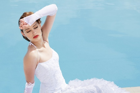 Sexy Lady in white wedding dress near  blue water Stock Photo - 10376823