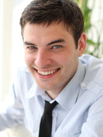 the well groomed: Closeup portrait of a smiling handsome man Stock Photo