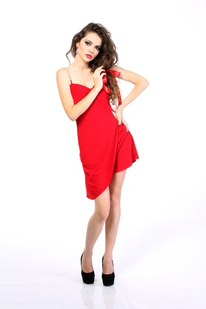 heeled: woman in red dress with long curly hair on white background