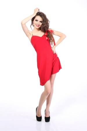 Young Woman in red dress. Studio photo