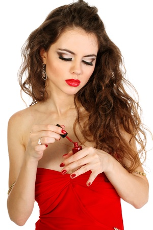 Woman with red lips paint your nails  photo