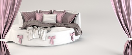 Round bed with pillows and silk  coverlet. Opened curtain. Demonstration.  photo
