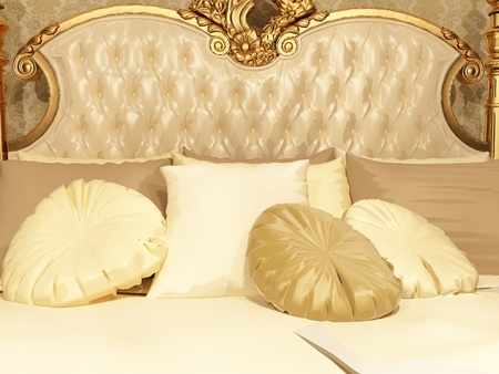 Pillows and button back of bed in luxurious bedroom interior. Home relaxation. photo