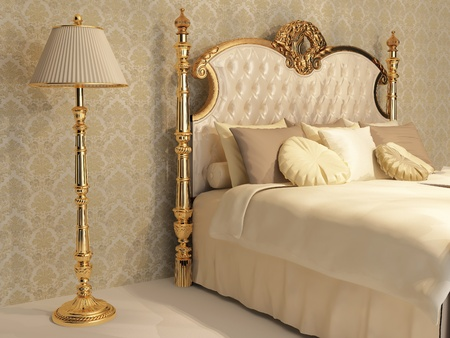 Luxurious bed with cushion and stand lamp in royal bedroom interior photo