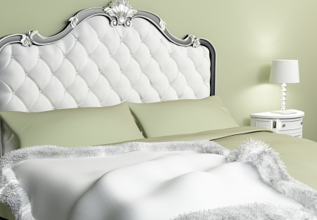 baroque furniture: Luxurious bed with pillows and bedspread in hotel interior