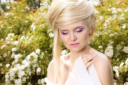 Portrait beauty sensual blonde young woman with hairstyle, nature photo