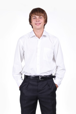 bristly: portrait of a stylish young man standing with hands in pockets over white background