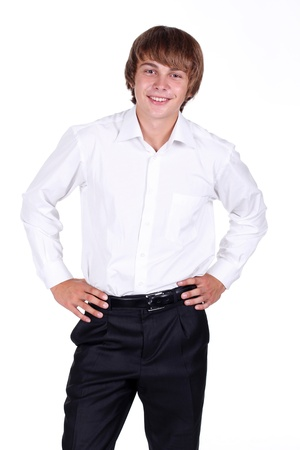 Smiling satisfied stylish young man standing with over white background Stock Photo - 10511841