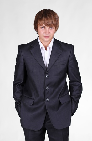 portrait of a young businessman posing in studio photo