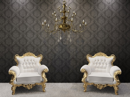 Golden chandelier with luxurious armchairs on black ornament background.  photo