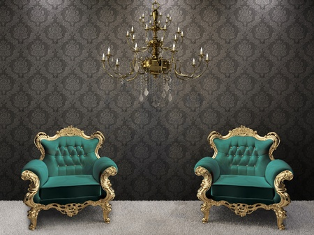 Royal interior. Golden chandelier with luxurious armchairs on black ornament background.  Stock Photo