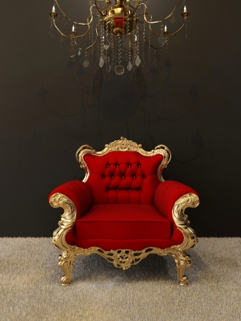 Luxury armchair with golden frames and royal chandelier in interior photo