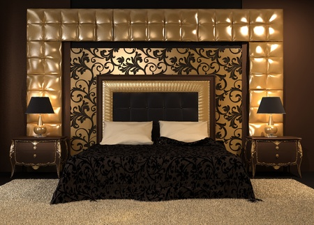 Front perspective of luxutiois double bed at royal apartment. Modern Interior at the hotel. Luxe furniture and pattern. Ornament of the wall.