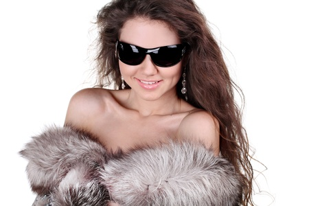 Fashion lady model with smile present fur coat, winter photo