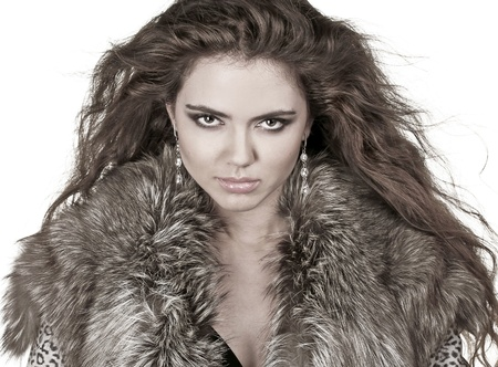 Beautiful woman in fur coat, fashion lady, curly hairstyle, winter Stock Photo - 10595741