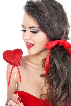 attractive smiling woman in red with heart on white background Stock Photo - 10635306