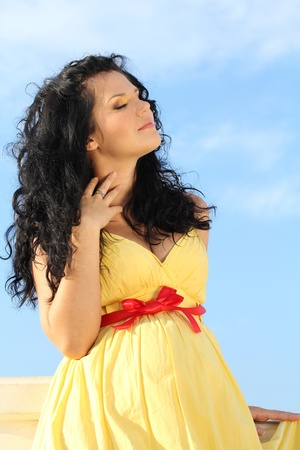 Portrait of Beautiful pregnant woman over sky Stock Photo - 10854555