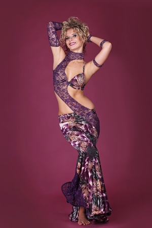 Flexible body of beautiful belly dancer in oriental dress Stock Photo - 11087368