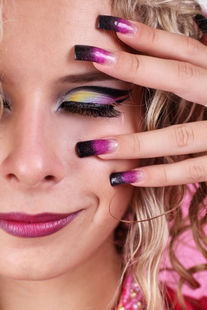 Fashion multicolored make-up and beauty purple manicure of fingernails photo