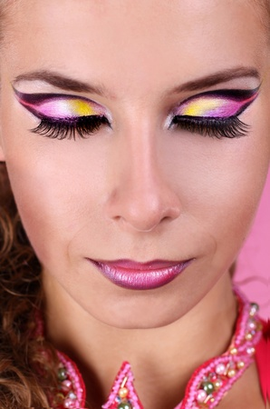 Beauty make up of woman over pink Stock Photo - 11087392