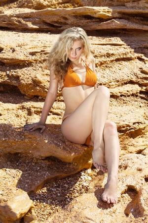 hot legs: Sexy female posing on beach Stock Photo