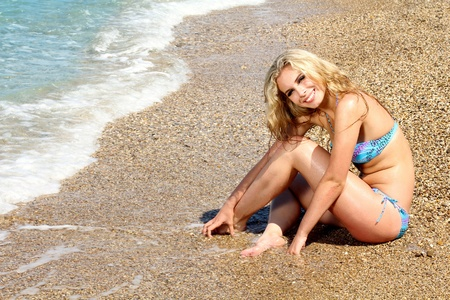 Happy young woman on the beach photo