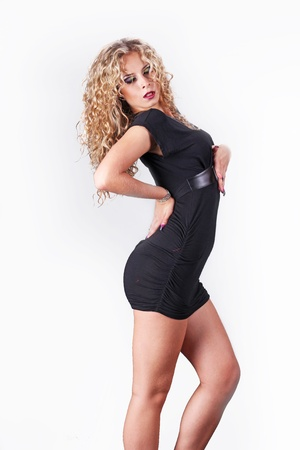 Sexy lady posing in black dress posing on white background Stock Photo - 11143075