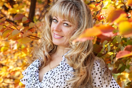 Close up of a middle aged woman over autumn, outdoors photo