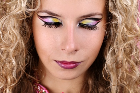 woman with makeup  shadow-eyes and blonde curly hair photo