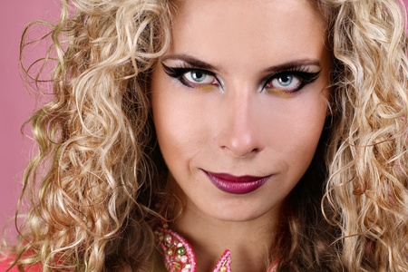 elegancy: Portrait of woman with blue eyes and blonde curly hair