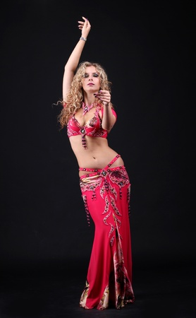 beautiful belly dancer woman on black background Stock Photo