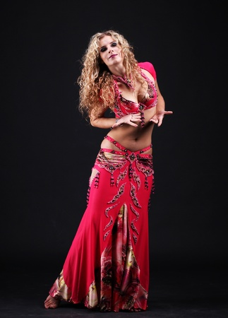 beautiful curly blonde in the active Arab Dance photo