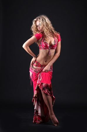 blonde in the active Arab Dance isolated on black background  Stock Photo