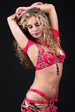 Beautiful women. Belly dancer in red suit. photo