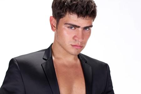 Close up of Brutal handsome man in black suit photo