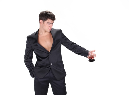 alcoholic man: Business man in black suit holding glass of cognac isolated on white background