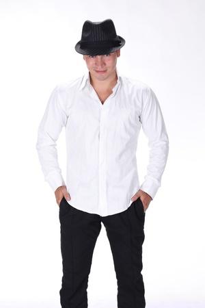 Posing stylish man with hat on white background photo