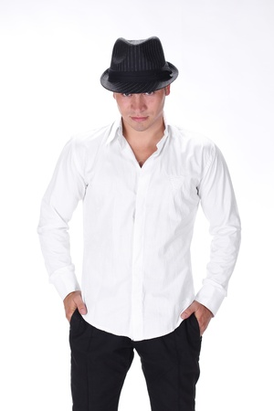 Posing man with hat on white background photo