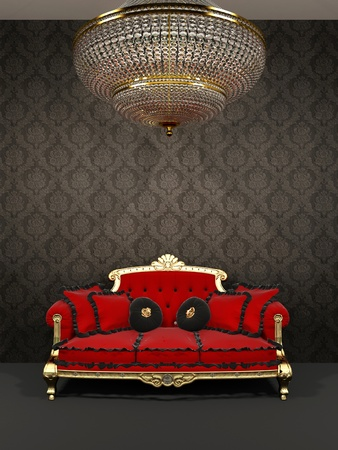 Red sofa and chandelier in royal interior  photo
