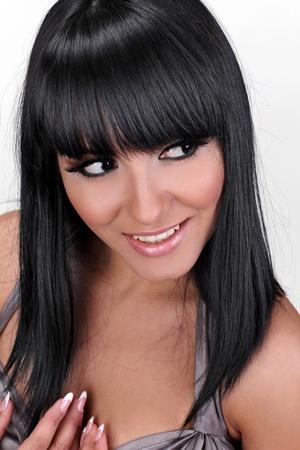 Smiling brunette woman hair cut photo