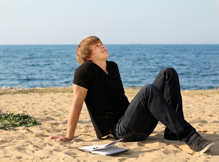 chilling: Handsome man relaxing on the beach