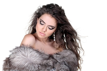 Sexy fashion woman in fur coat with make up photo
