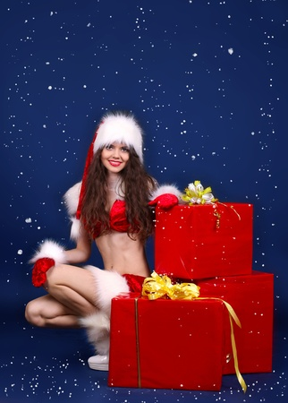 Girl present gift in Santa Claus clothes photo