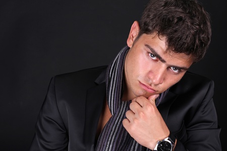 Close up of Handsome man looking intense gaze in stylish suit. photo