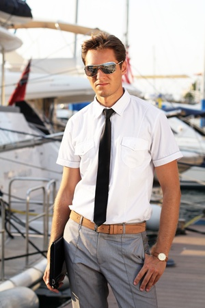 yacht people: business professional man over yacht outdoors background