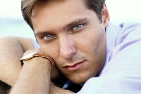 lucky man: Portrait of handsome man, close up of young businessman, outdoors  Stock Photo